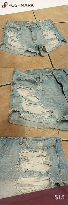 Abercrombie and Fitch distressed shorts Abercrombie and Fitch distressed shorts  size 8 waist 29 high waisted  cuts on both side see picture Abercrombie & Fitch Shorts