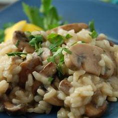 Gourmet Mushroom Risotto.....I added a roasted red peeper and fresh spinach :) Heaven!