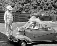 """at home in Memphis in his three wheeled Messerschmitt bubble car"""" with his grandfather, Jessie Presley, 1956. Photo by Phillip Harrington."""