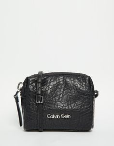 Image 1 ofCalvin Klein Pebbled Textured Across Body Bag with Chunky Zip
