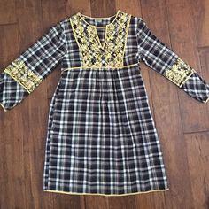 Black yellow and white plaid dress Black yellow and white plaid dress yellow embroidery. So cute on. Fits size 4-6 Dresses Midi