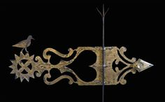 A distressed banner weathervane reproduction by sculptor Mark A. Perry.  Aged iron, blacksmith forged lightning strike, hand rivets and 23k gold leaf.  53 inches long.  www.MarkAPerry.com
