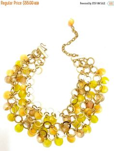 Kramer Three Strand Necklace, Golden Yellow Acrylic Disk Dangles, Textured and Smooth Gold Tone Metal, Statement Necklace, Designer Signed by Vintageimagine on Etsy https://www.etsy.com/listing/398199085/kramer-three-strand-necklace-golden