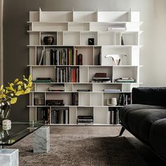 Wally bookcase by CATTELAN ITALIA Modular bookcase in white (GF71), black (GF73), graphite (GF69), oyster (GF50) or ottanio (GF80) lacquered embossed MDF. Max capacity: kg 60 (105), kg 45 (65), kg 40 (B), kg 20 (P) spread load. http://www.format-store.com/en/prod/living-area/library/wally-bookcase-by-cattelanitalia.html
