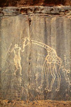 Engraved giraffe, human figure and Libyan-Berber Script, Tadrart, Algeria.  © David Coulson/TARA