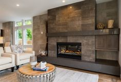 tile around fireplace ideas fireplace wall 19 Stylish Fireplace Tile Ideas for Your Fireplace Surround Modern Fireplace Tiles, Tile Around Fireplace, Subway Tile Fireplace, Granite Fireplace, Fireplace Tile Surround, Linear Fireplace, Home Fireplace, Fireplace Remodel, Fireplace Surrounds