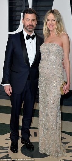 Bumping along nicely: The evening's host, Jimmy Kimmel was joined by his pregnant wife Molly McNearney, who showed off her growing bump in a strapless nude gown which helped make her dazzle among the stars