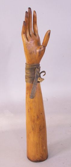 Antique 19th century French wooden glove mold made from fruitwood. This hand is so well made and designed it looks like a piece of sculpture. Measures 19 and one half inches high. The thumb moves back and forth. Purchased in France many years ago.