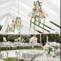 This tent is pure but whimsical and romantic. You get the feeling of a lovely refreshing breeze. Very pretty partial draping. Real Weddings in Martha Mag.