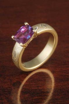 Mokume Solitaire Straight Tapered Engagement Ring with an alexandrite center stone.