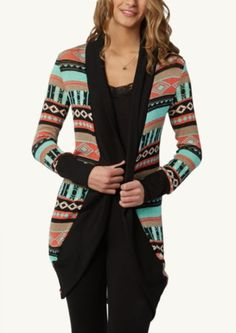 A colourful cardigan makes a beautiful accent to an all black outfit. Find similar at http://mandysheaven.co.uk/ - Womens Fashion Boutique UK - Cambridge Style