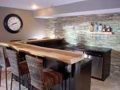 Explore basement bar ideas and designs at HGTV for tips on how to transform your basement space into a chic bar area.