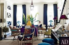 NY Townhouse. Love the jewel tones matched against the white and dark wood