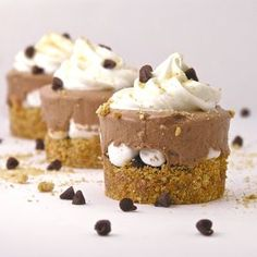 Frosty S'more Cups  18 graham cracker squares (9 sheets)  1/3 c. butter  1/2 c. milk chocolate chips  1/4 c. whipping cream  2 c. mini marshmallows  1 1/2 c. cold milk  1 box (4 servings, 3.9 oz)instant chocolate pudding  1 (8 oz) container of Cool Whip (thawed in fridge)  1/4 c. mini chocolate chips (as topping)