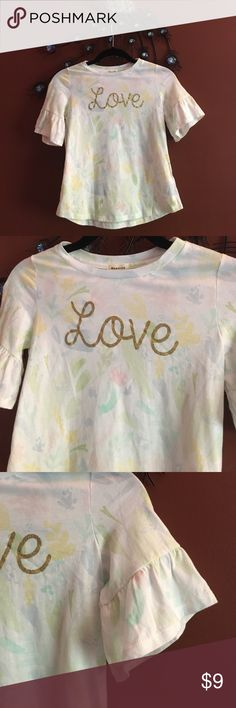 """Little Girls flare sleeve LOVE glitter top NWT M Little Girls flare sleeve LOVE glitter top By Monteau 100% Cotton. Armpit to armpit 14"""" length 19"""". Floral print with glitter glue Love writing. Monteau Shirts & Tops Tees - Short Sleeve"""