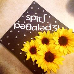 Made this simple graduation cap.. includes 3 of my favorite things! sunflowers, rhinestones & phonetics :) #graduationcap #phonetics #speechpathology #speechpathologygraduationcap #SLP2B #sunflowers #simplegraduationcap #DIYgraduationcap