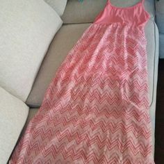 Coral sundress Very cute coral chevron sundress with lining. Brand new dress.  Received as a gift but too small. Rue 21 Dresses