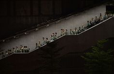 Police walk down a stairwell as pro-democracy demonstrators gather for a rally outside the Hong Kong government headquarters on September 29, 2014. Police repeatedly fired tear gas after tens of thousands of pro-democracy demonstrators brought parts of central Hong Kong to a standstill on September 28 in protest at Beijing's refusal to grant the city unfettered democracy. (Dale La Rey/AFP/Getty Images) #