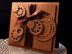 Gears to You.  This coud be duplicated with  the Spellbinders cogs die set, I think.  The little  saying could be computer generated in smalltext and put in one of the circles.