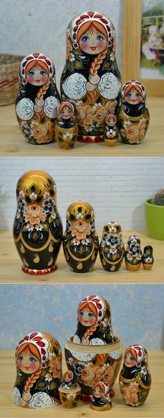 Russian nesting doll in black, white and gold decor hand painted by artist Nadezhda Tihonovich. Find more gorgeous matryoshka dolls at: www.bestrussiandolls.etsy.com