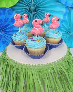 Flamingo cupcakes with neon fish sprinkles. Cute!