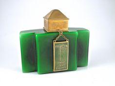 1928 Baccarat, Myon Coeur de Femme perfume bottle, green cased crystal, clear stopper, enameled metal cap and hangtag label. Baccarat mark. 3 1/4 in.