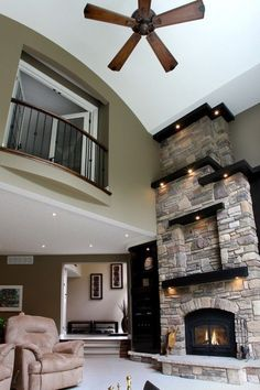Love love love this fireplace with multiple, asymmetrical / offset mantels...
