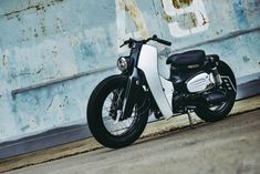 We saw the 2018 Honda Super Cub. TBH, we are hardly impressed, but this one here, a custom by K-Speed, is a whole new ball game. It made us wish the 2018 Honda Super Cub Honda Cub, Retro Bike, Retro Motorcycle, Motorcycle Shop, Scooter Custom, Custom Bikes, New Honda, Commuter Bike, Honda Logo