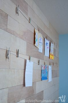 The perfect way to display your kids art, or your own! Use boat cleats to make an easy nautical art display wall. Tutorial on HousefulofHanmade.com.