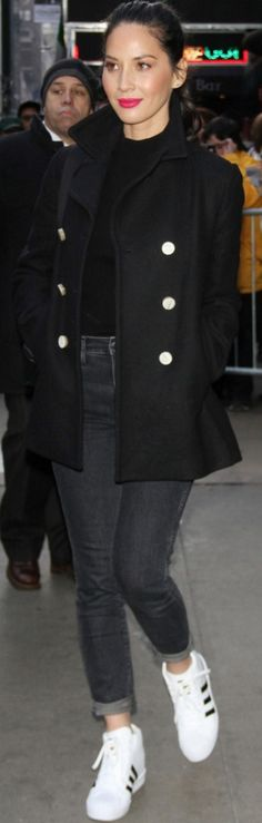 Who made Olivia Munn's white sneakers, black coat, and turtleneck sweater?