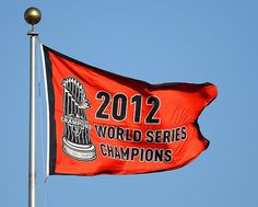 5/4/13. GORGEOUS!  The Giants 2012 Championship banner flutters in the breeze on a warm day at AT& T Park in San Francisco.