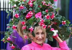 Blooming marvellous: Race goer Florence Claridge from Dover looked radiant in a gigantic hat inspired by beautiful fuchsia bushes. The lady featured on my bling board last year!