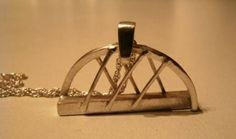 'Arc' pendant inspired by the 'Squinty Bridge' which spans the River Clyde in Glasgow, Scotland
