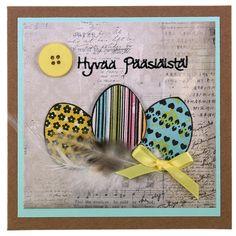 Leimaillen valmistettu pääsiäiskortti. Koristeena myös nappeja, nauhaa ja höyheniä! Tarvikkeet ja ideat Sinellistä!