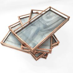 DEBBIE BEAN CARRARA WHITE STAINED GLASS TRAYS | A stained glass tray / valet made of stained glass and lead-free, silver alloy solder, with a copper finish. The opaque glass is reminiscent of carrara marble and the sides are made of clear waterglass. Due to the nature of the glass, no two valets will have the same pattern.   This catchall is perfect for holding your jewelry, wallet, keys or to create a crystal grid on.