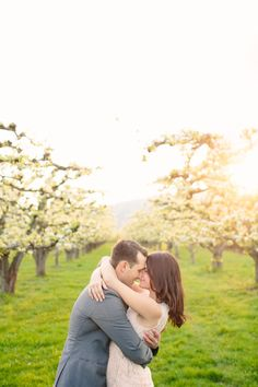 Okanagan Apple Blossom Engagement Session by Adrian Photography  Read more - http://www.stylemepretty.com/canada-weddings/2013/06/11/okanagan-apple-blossom-engagement-session-by-adrian-photography/
