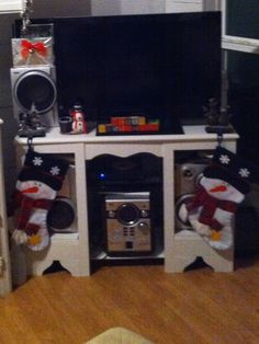 Tv stand holds stockings