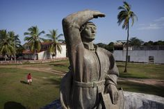 A statue of Portuguese explorer Diego Cao is seen at an old Portuguese slave fort in Cacheu, Guinea-Bissau