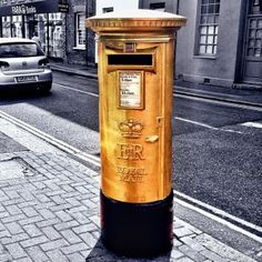 Red Post Boxes repainted #Gold near #Olympic Winners homes .