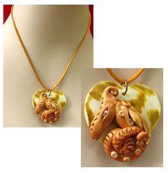 Gold/Bronze Dragon on Heart Shell Pendant by britpoprose99 on Etsy, $14.99