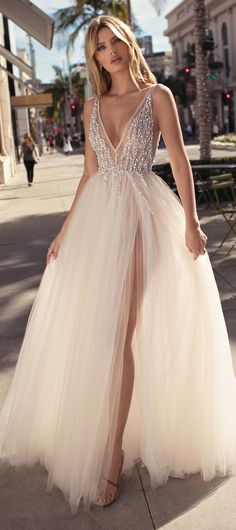 Ball Gown Wedding Dress by MUSE BY BERTA | Princess bridal gown with plunging v-neckline and tulle skirt | Sperkly wedding gown | #weddingdress #weddingdresses #bridalgown #bridal #bridalgowns #weddinggown #bridetobe #weddings #bride #weddinginspiration #dreamdress #fashionista #weddingideas #bridalcollection #bridaldress #fashion #bellethemagazine #ido #dress