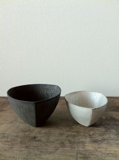 Black and silver bowls by Aoki Ryota