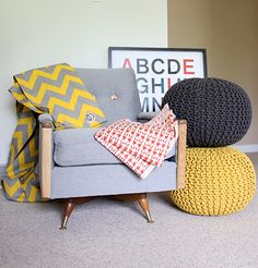 Nursery colour scheme. Grey, yellow, red. Gender neutral and cozy. Updated Mid-century upholstered, swivel rocking chair. Yellow/grey palette.