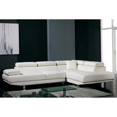 "T60 Modern Sectional Sofa  Graceful in white is this low-profile designed ultra modern sectional sofa with flat adjustable headrests, wide armrest and cubed-shaped chaise.  Solid wood frame and flat stainless steel legs provide long-term support while the high density cushioned seats and backrests offer warmth and comfort. This eye-catching design is sure to add brilliance to your living space.  Sectional Pieces:    	Sofa: Width: 72"" - Back To Front: 42"" - Height: 29"" (with headrests: 38"")…"