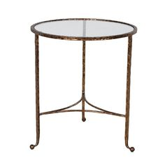 http://www.sweetpeaandwillow.com/living-room/side-tables/oval-iron-glass-table