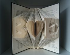 paper anniversary gift for husband/wife or more.....  A folded book art with Any 2 initials of your choice and a heart in between. Please leave me a message of the initials while check out.  A❤B❤C❤D❤E❤F❤G❤H❤I❤J❤K❤L❤M❤N❤O❤P❤Q❤R❤S❤T❤U❤V❤W❤X❤Y❤Z  Please do not request any specific book.Not every book is suitable for this folded book. I choose book base on pages and thickness. I bought most of my books from local libraries/charities and put a new life on them. Books are chosen randomly(mainly…