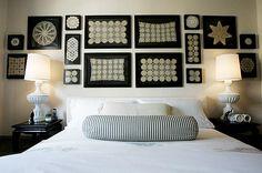 Framed doilies. White on black matting and frames.