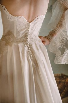 Claire Pettibone Marie strapless wedding dress with lace embroidered bodice, silk buttons down the back, and flowing cotton skirt and long train. Elaborate lace and tulle sheer long sleeves. Wedding Dress Backs, Best Wedding Dresses, Wedding Gowns, Embroidered Wedding Dresses, Bridal Gown, Wedding Blog, Modest Wedding, Tulle Wedding, Embroidered Lace