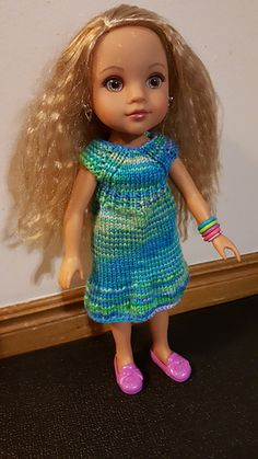 This little doll dress is a quick knit. The pattern has been modified to be worked top-down. It fits a 14-inch Les Cheries doll.