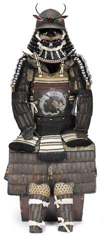 An armor with a silver dragon design Helmet and cuirass by Shigekatsu, Edo period (19th century)